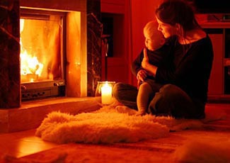Getting warm and cosy by an open fire