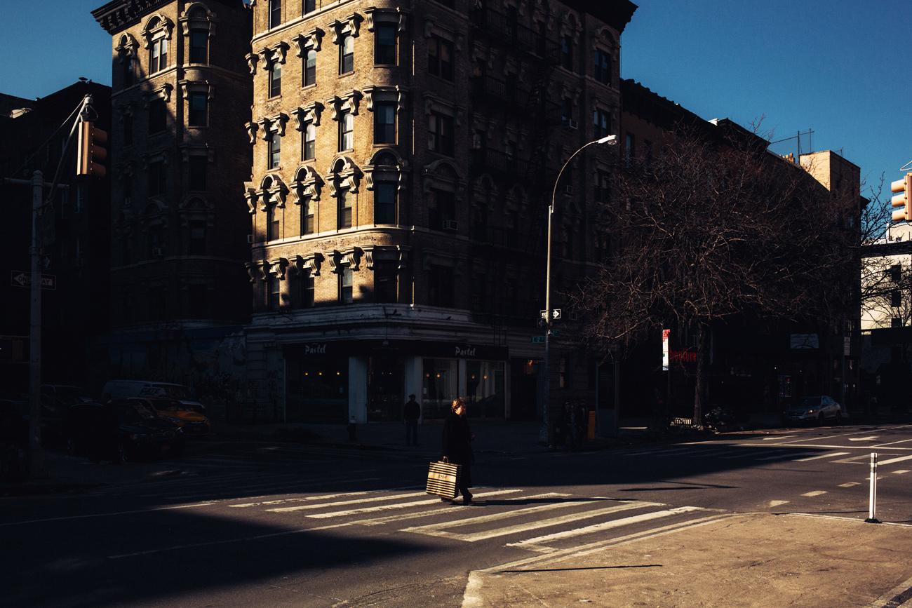 new york street photo buildings slice of light