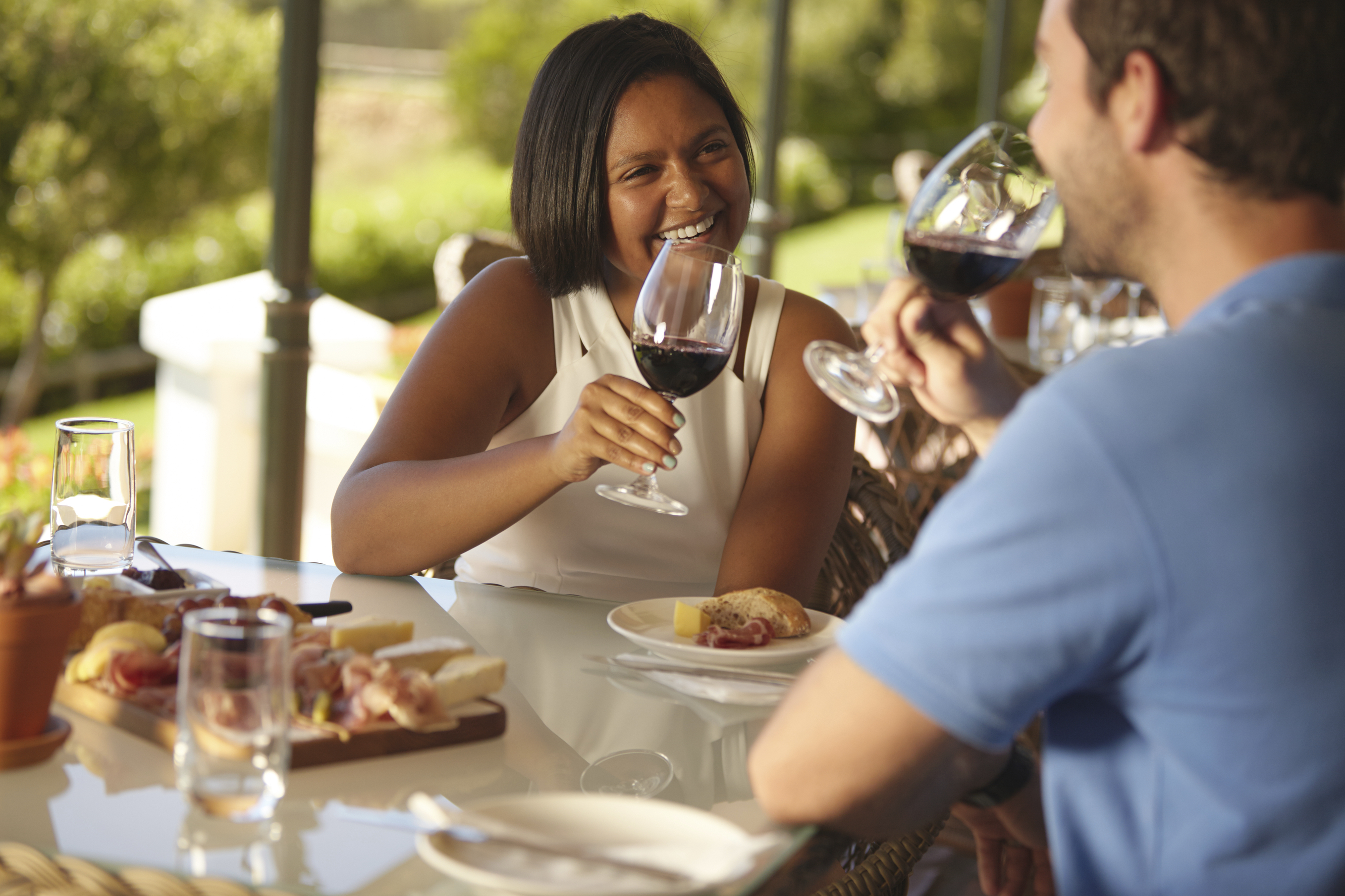 young couple drinking red wine