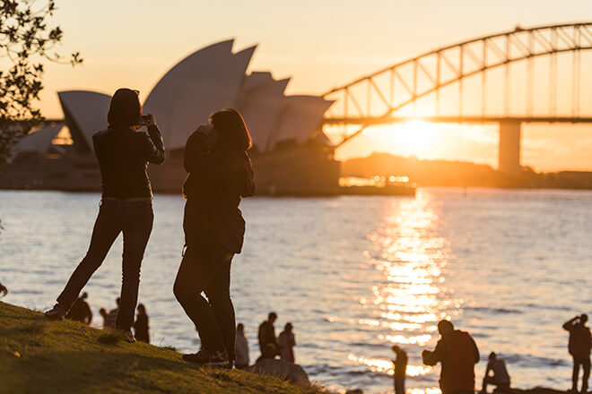 People taking photos of Sydney Opera House from the Royal Botanic Garden