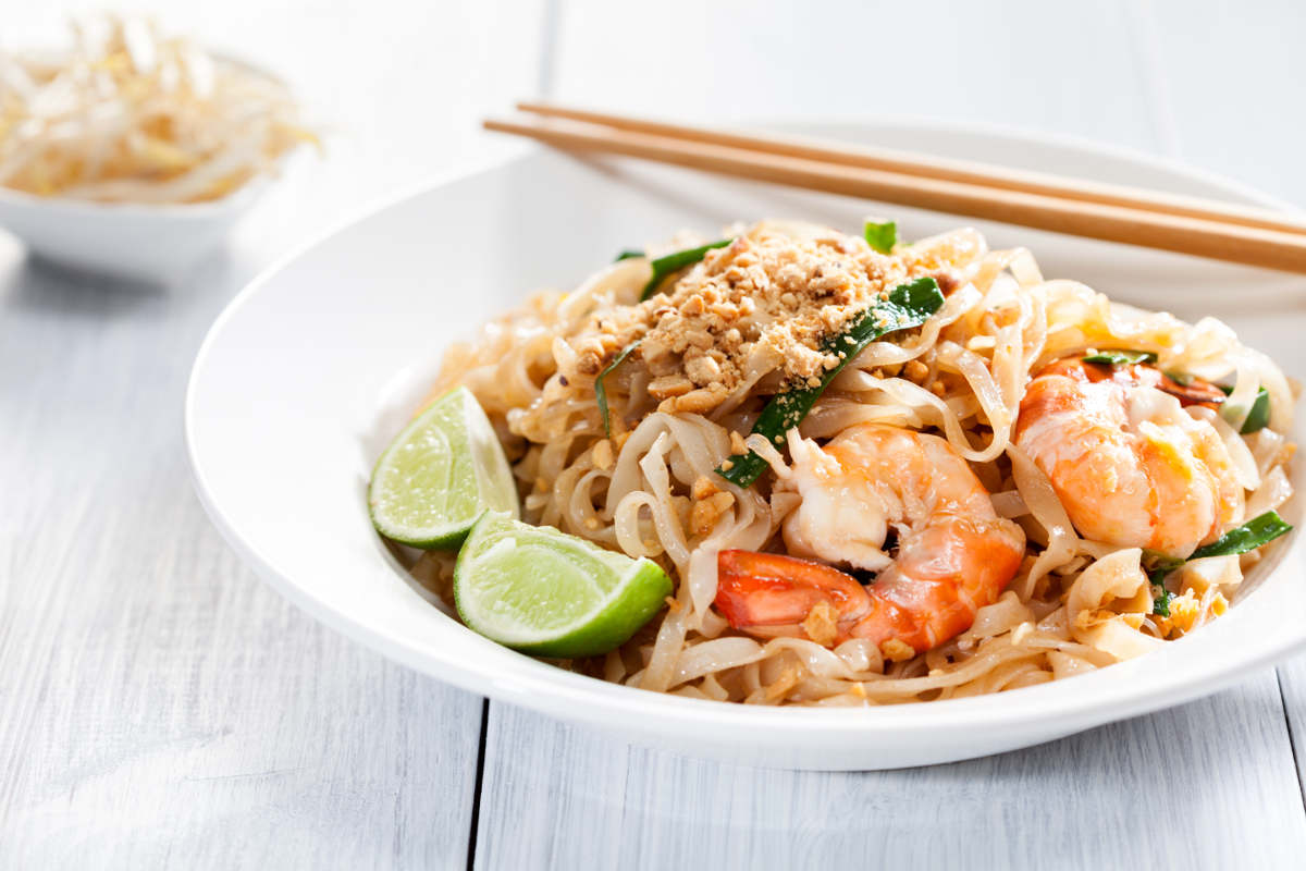 prawn noodles with lime on the side