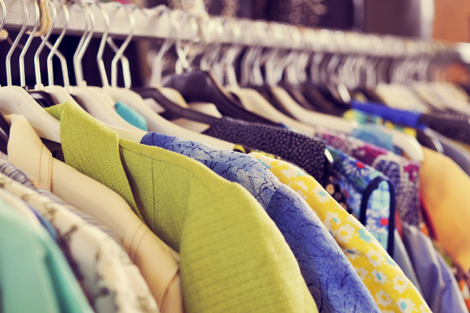 Shirts on a rack in a vintage clothing shop