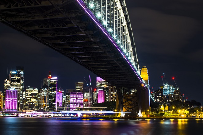 Sydney Harbour Bridge bathed in neon light