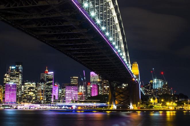 Sydney Harbour Bridge bathed in neon light