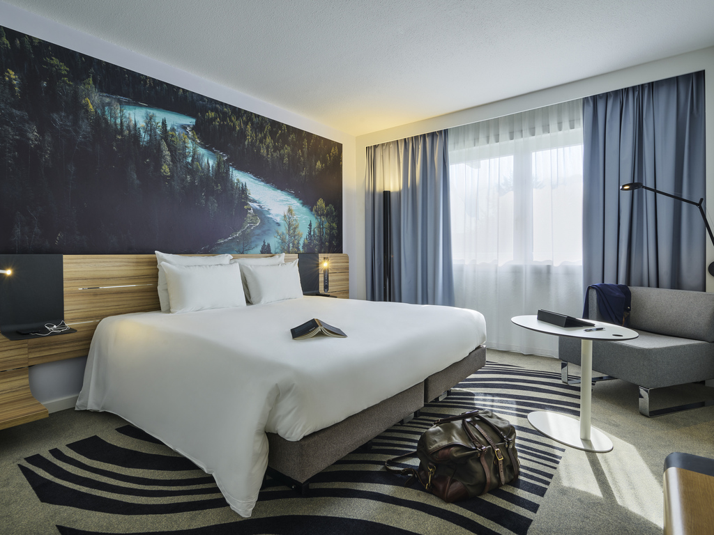 Just 15 minutes from Paris, choose the intimate elegance of the Novotel Massy Palaiseau hotel, 875 yds (800 m) from the Massy TGV train station. In the heart of the business district, the hotel boasts 8 meeting rooms to ensure the success of your business trips. Enjoy unforgettable private events in our large wooded park. Relax in comfortable rooms with WIFI and air conditioning. Enjoy the friendly atmosphere as you sample the cuisine in our restaurant, or enjoy the outdoor pool. Think big at Novotel